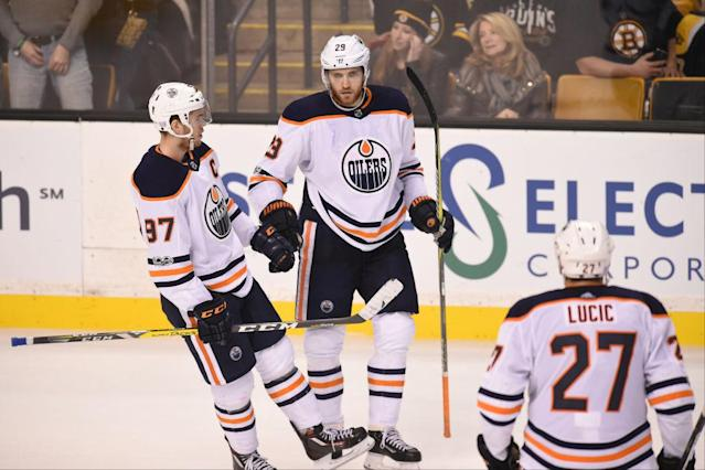 "<a class=""link rapid-noclick-resp"" href=""/nhl/players/6743/"" data-ylk=""slk:Connor McDavid"">Connor McDavid</a> and the <a class=""link rapid-noclick-resp"" href=""/nhl/teams/edm/"" data-ylk=""slk:Edmonton Oilers"">Edmonton Oilers</a> have a long way to climb, and could probably use some outside help. (Getty Images)"