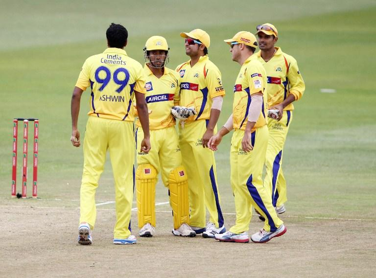 Chennai Super Kings players celebrate a wicket during on October 22, 2012 during a Champions League T20 (CLT20) match against Yorkshire at the Kingsmead stadium in Durban. AFP PHOTO / STR