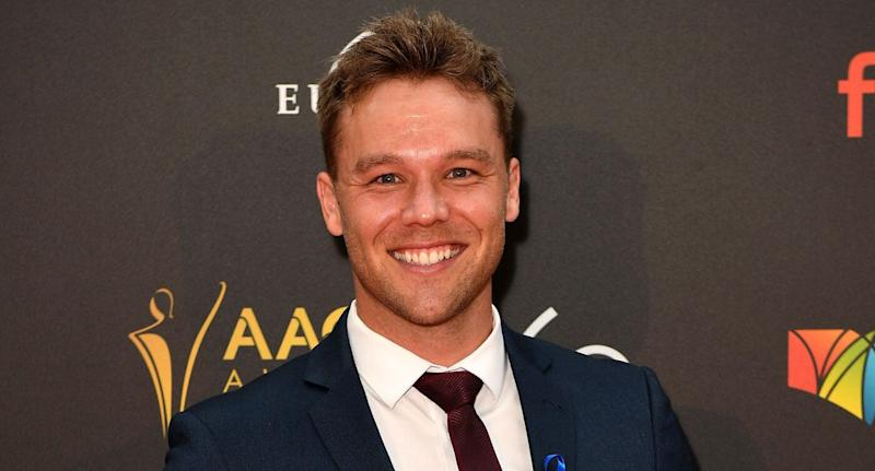 Home and Away actor Lincoln Lewis pictured at the 2018 AACTA Awards. A Melbourne woman allegedly used his image to prey on young women online.