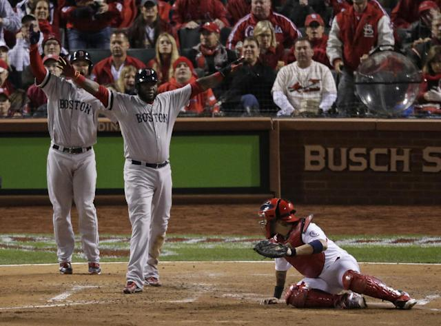 Boston Red Sox's David Ortiz reacts after sliding safely past St. Louis Cardinals catcher Yadier Molina during the fifth inning of Game 4 of baseball's World Series Sunday, Oct. 27, 2013, in St. Louis. Ortiz scored from third on a sacrifice fly by Stephen Drew. (AP Photo/Charlie Riedel)