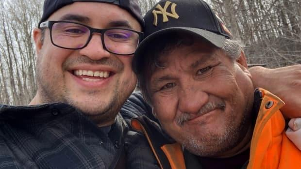 Jake Sansom (left) and Maurice Cardinal were near Siebert Lake when they were shot to death. They took this photo on the day they were killed.  (Submitted by Mike Sansom - image credit)