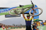 <p>Jenny Rissveds of Sweden celebrates after winning the women's cross-country mountain bike race at the 2016 Summer Olympics in Rio de Janeiro, Brazil, Saturday, Aug. 20, 2016. (AP Photo/Patrick Semansky) </p>
