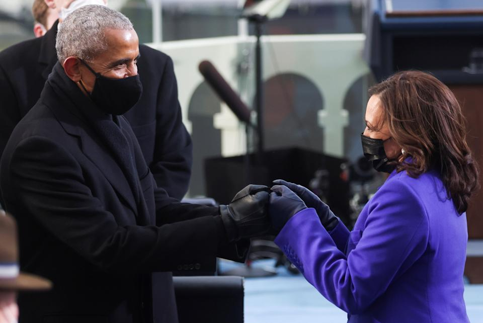 <p>Ms Harris shares a moment with Barack Obama, the first black president, at the inauguration</p> (REUTERS)