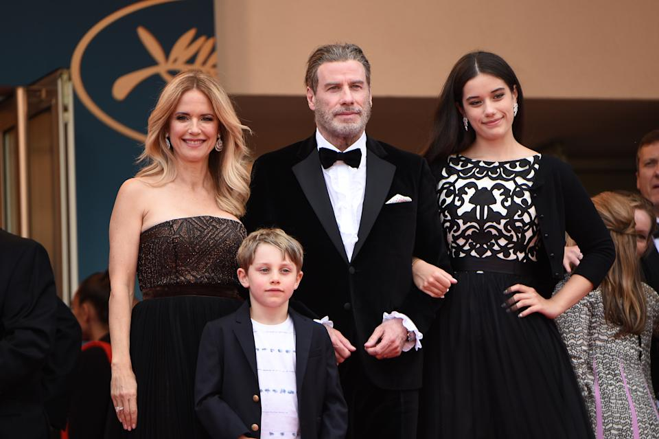 Kelly Preston (L) and John Travolta pose with their children Ella Bleu Travolta (R) and Benjamin Travolta during the 71st annual Cannes Film Festival in 2018. (Photo by Nicholas Hunt/Getty Images)
