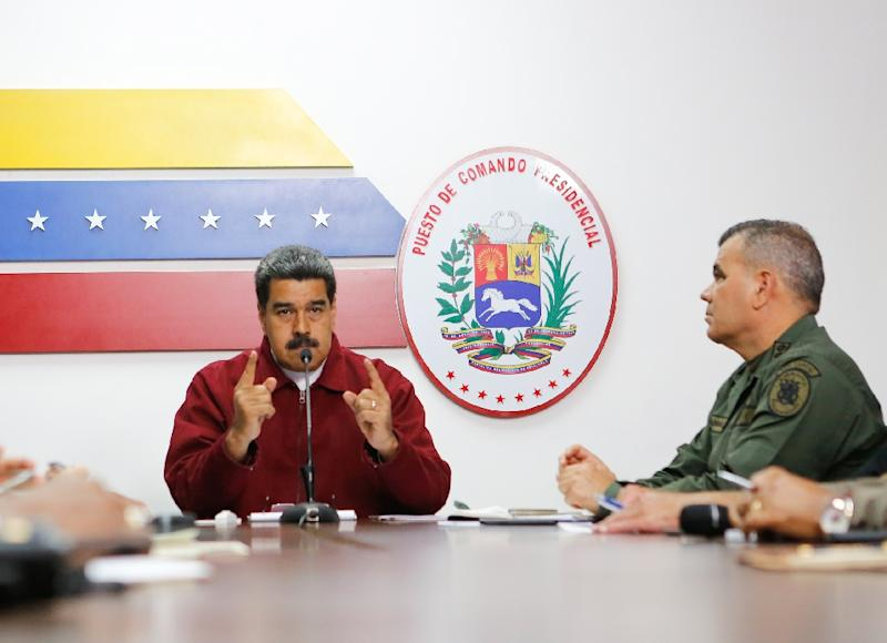 A handout photo released by the Venezuelan presidency's press office showing Nicolas Maduro (L) speaking next to Defense Minister Vladimir Padrino (R) at the Miraflores presidential palace in Caracas (AFP Photo/HO)