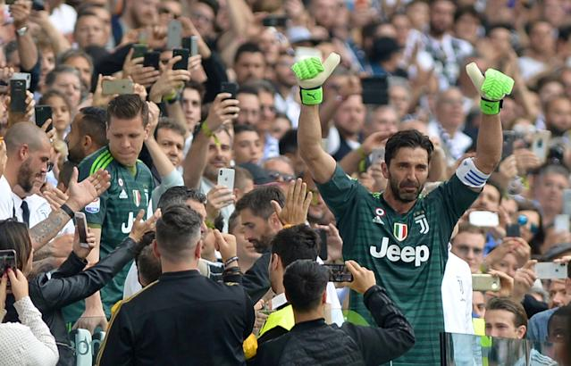 FILE PHOTO: Allianz Stadium, Turin, Italy - May 19, 2018 Juventus' Gianluigi Buffon gestures to the fans as he is substituted off REUTERS/Massimo Pinca/File Photo