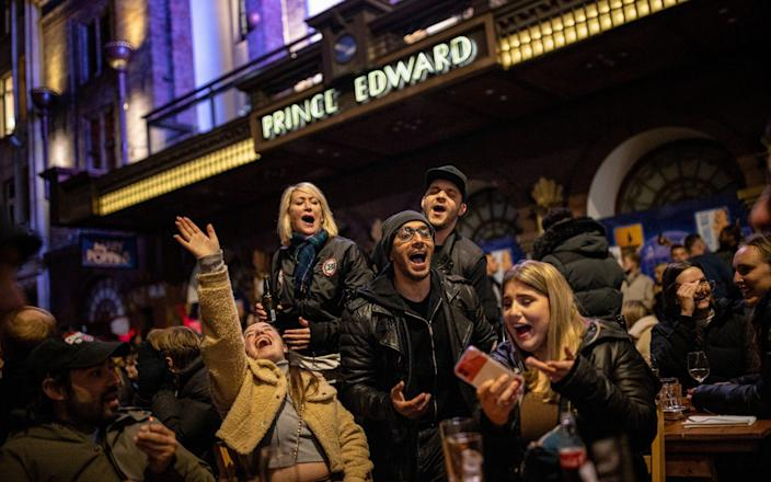 A group of people sing Happy Birthday while enjoying drinks on Old Compton Street in Soho - Rob Pinney/Getty Images Europe