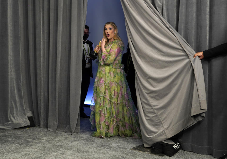 "Emerald Fennell, winner of the award for best original screenplay for ""Promising Young Woman,"" poses in the press room at the Oscars on Sunday, April 25, 2021, at Union Station in Los Angeles. (AP Photo/Chris Pizzello, Pool)"