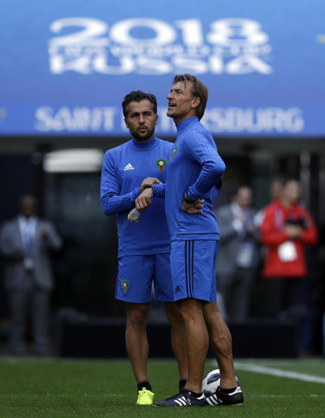 Morocco coach Herve Renard, right, with team official during the official training of Morocco on the eve of the group B match between Morocco and Iran at the 2018 soccer World Cup in the St. Petersburg Stadium in St. Petersburg, Russia, Thursday, June 14, 2018. (AP Photo/Themba Hadebe)