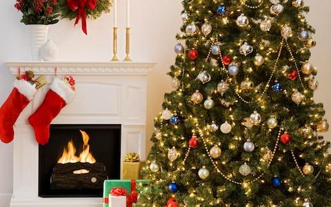 Christmas tree next to a fire - Credit: Getty
