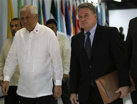 Philippine Foreign Affairs Secretary Albert Del Rosario (L) walks with U.S. Representative Chris Smith upon arrival at the Department of Foreign Affairs headquarters in Pasay city, metro Manila November 25, 2013. REUTERS/Romeo Ranoco