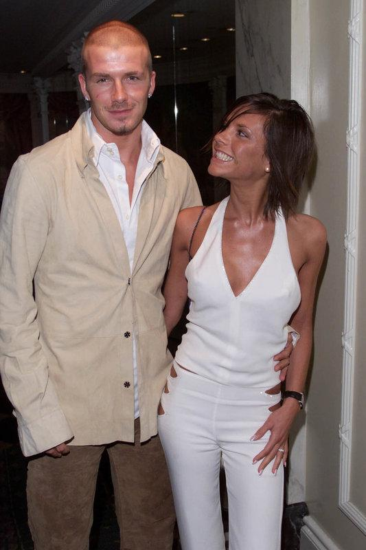 David and Victoria at the Silver Clef Awards in 2001 matching again in white and cream tones. She clearly approves of his shaved head.