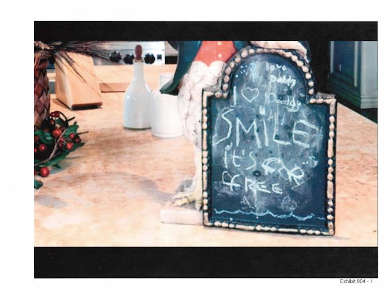 In this undated photo released by the LA Superior Court and presented as evidence, a 2009 message written by Paris Jackson about her father, Michael Jackson, is seen on a chalkboard that was placed in the kitchen of the singer's rented mansion in Los Angeles. The message remained on the board on the day Jackson died in June 2009, and was described to a jury hearing a case in Los Angeles filed by Jackson's mother by the singer's chef, Kai Chase, during testimony on Tuesday, June 18, 2013. (AP Photo/LA Superior Court)