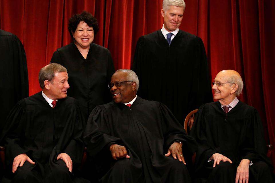 U.S. Chief Justice John Roberts (seated L-R), Justice Clarence Thomas, Justice Stephen Breyer, Justice Sonia Sotomayor (top L) and Justice Neil Gorsuch (top R) chat during a new U.S. Supreme Court family photo including Gorsuch, their most recent addition, at the Supreme Court building in Washington, D.C., U.S., June 1, 2017.