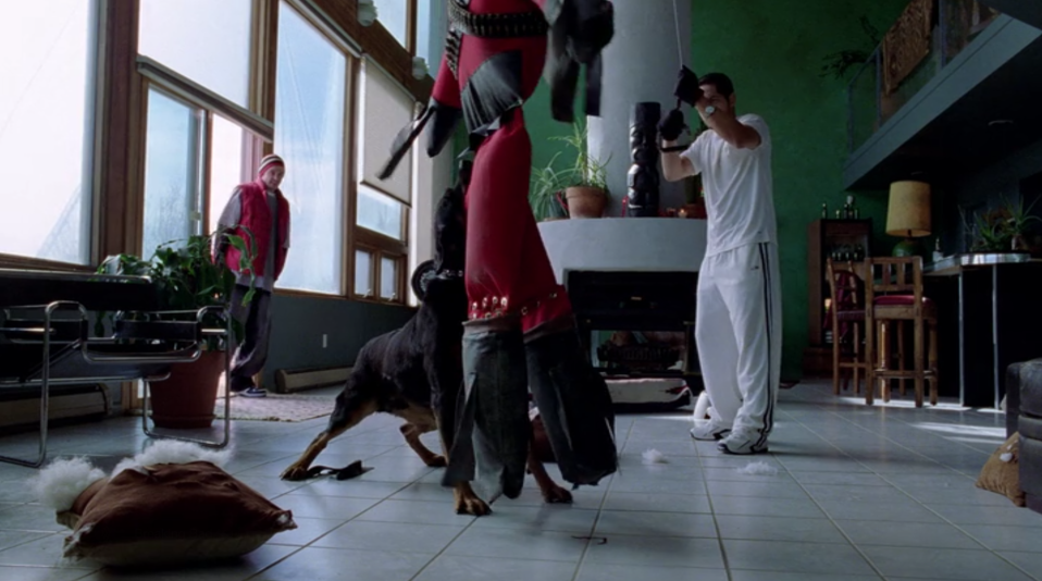 Jesse (Aaron Paul) pays Krazy-8 (Max Arciniega) and his attack dog a visit. (Screengrab: Netflix)