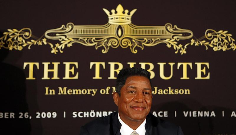"""FILE - In this Sept. 10, 2009 file photo, Jermaine Jackson, bother of late U.S. pop star Michael Jackson, smiles prior to a press conference on """"The Tribute - In Memory of Michael Jackson"""" in Berlin. Concert giant AEG Live filed a motion on Monday, Sept. 10, 2012 seeking Jermaine Jackson's drafts and manuscripts for books on his superstar brother, claiming they may reveal important details that will help it defend against a lawsuit filed by Jackson family matriarch Katherine Jackson. (AP Photo/Franka Bruns, File)"""