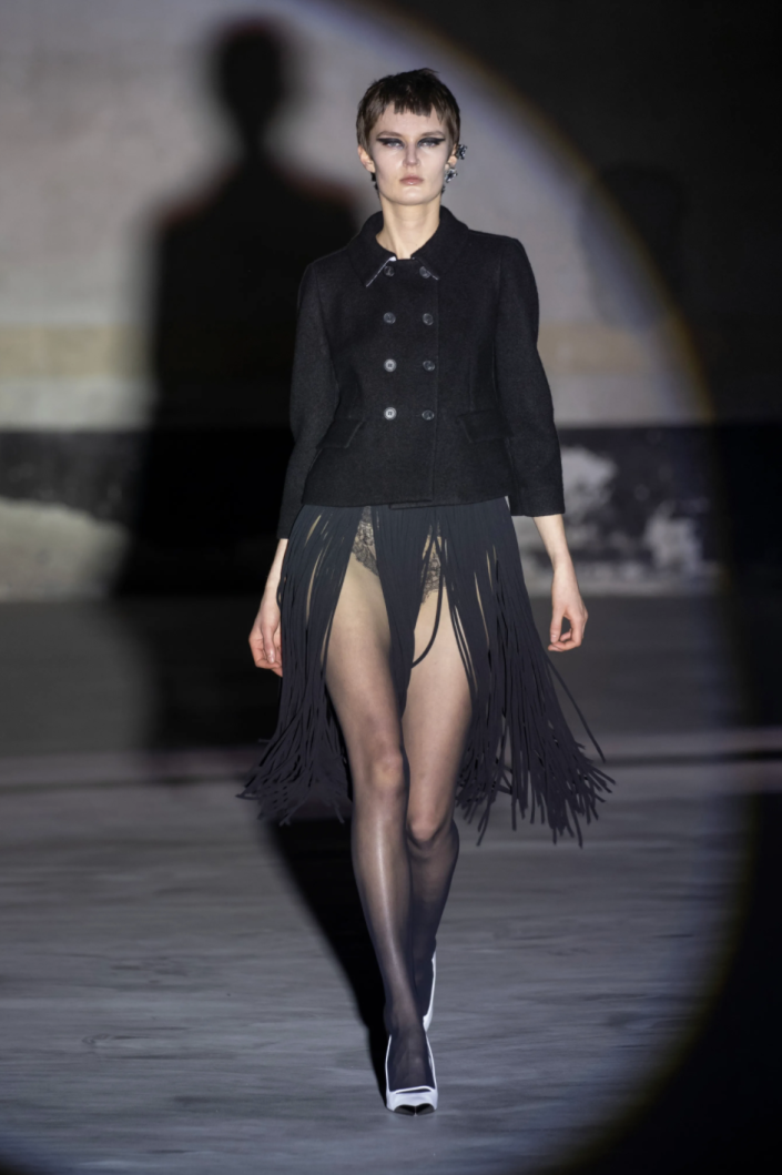 <p>For No. 21's fall 2021 collection, designer Alessandro Dell'Acqua presented looks that each highlighted a sensual part of the body: A cropped Bar jacket with a fringe skirt accented the legs, an ocelot-printed brassiere and matching pencil skirt showcased the midriff, and fitted strapless lace dress accentuated the arms and shoulders. The lineup was a celebration of the subtle sex appeal; there was nothing flagrant about the display of flesh. His inspiration was, after all, Carlo Mollino, the famed photographer, architect, and product designer whose work often reflected the curves of the female form.—<em>Barry Samaha </em></p>
