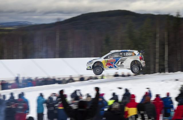 Finland's Jari-Matti Latvala and his co-driver Miikka Anttila drive their Ford Fiesta WRC on their way to the overall victory in the Rally of Sweden in Hagfors February 8, 2014. REUTERS/Micke Fransson / TT News Agency (SWEDEN - Tags: SPORT MOTORSPORT TPX IMAGES OF THE DAY) NO COMMERCIAL OR BOOK SALES. SWEDEN OUT. NO COMMERCIAL OR EDITORIAL SALES IN SWEDEN