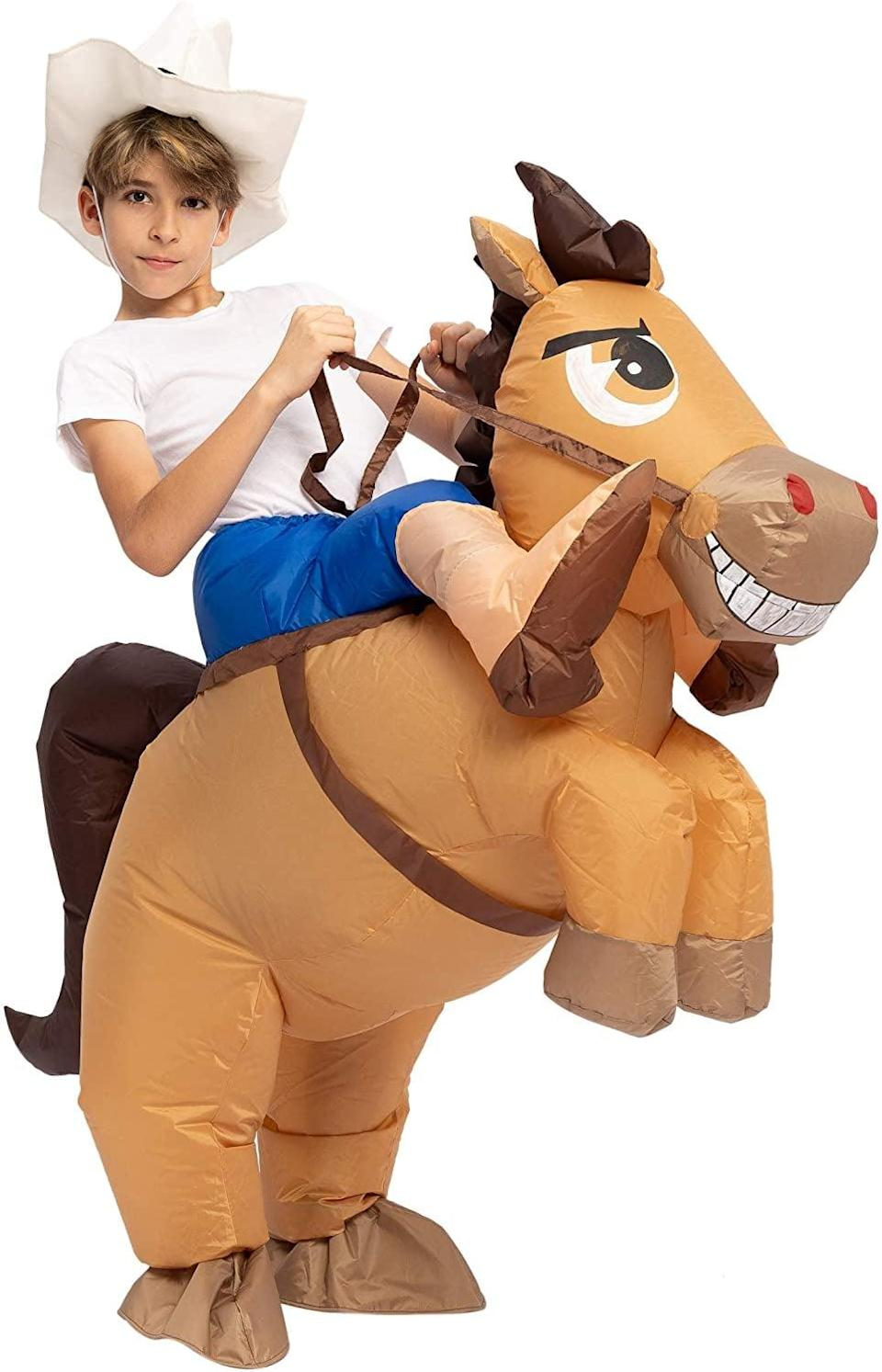 <p>Giddy on up! The <span>Spooktacular Creations Inflatable Cowboy Riding a Horse Halloween Costume </span> ($30) will make your kid look like a regular Butch Cassidy.</p>