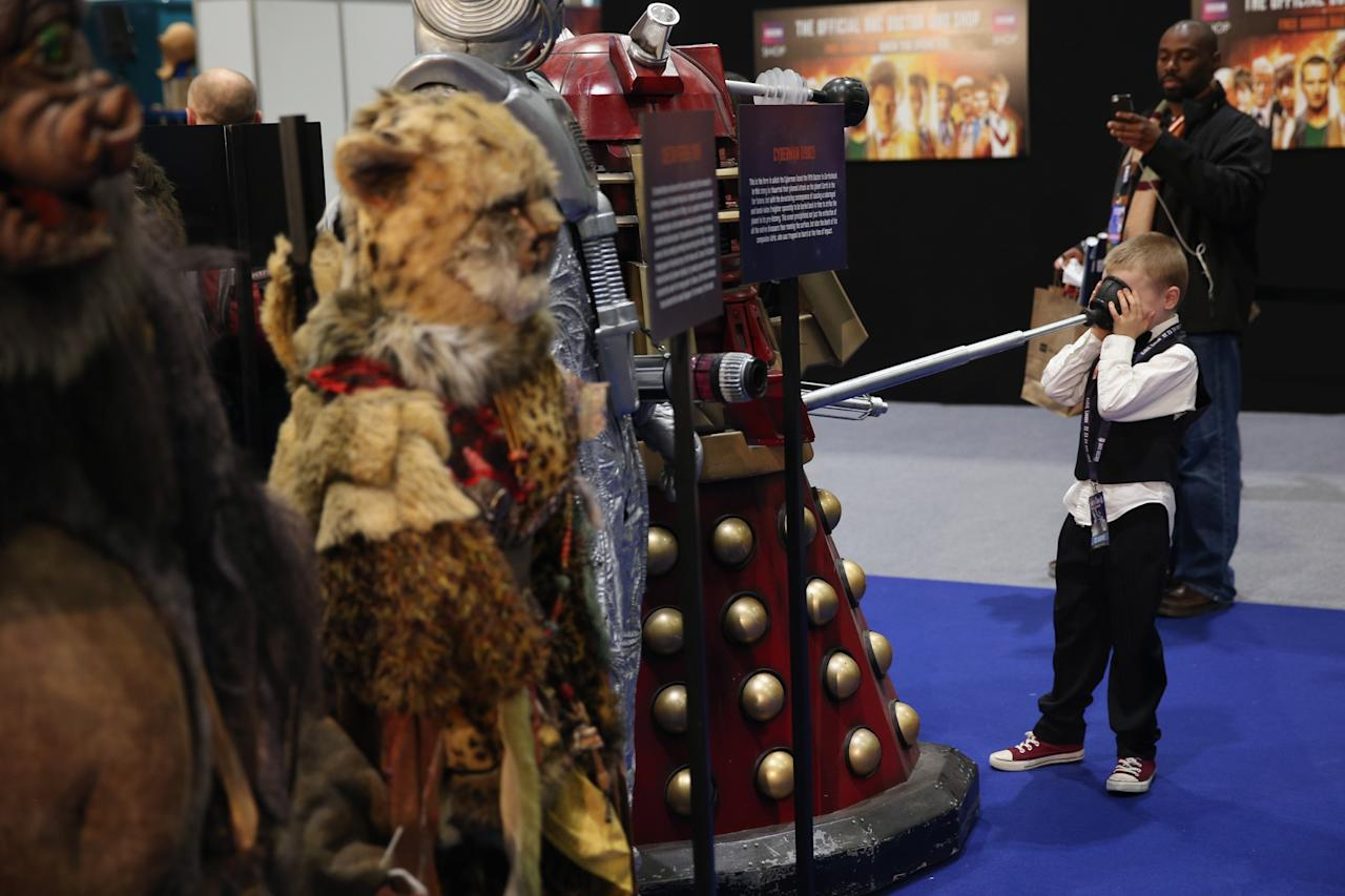 LONDON, ENGLAND - NOVEMBER 22: A young Doctor Who fan experiences a dalek model at the 'Doctor Who 50th Celebration' event in the ExCeL centre on November 22, 2013 in London, England. The sold-out three day event in the ExCeL London convention centre celebrates 50 years of the show which has seen 11 actors play the role of Doctor Who and receives a worldwide cult following. (Photo by Oli Scarff/Getty Images)