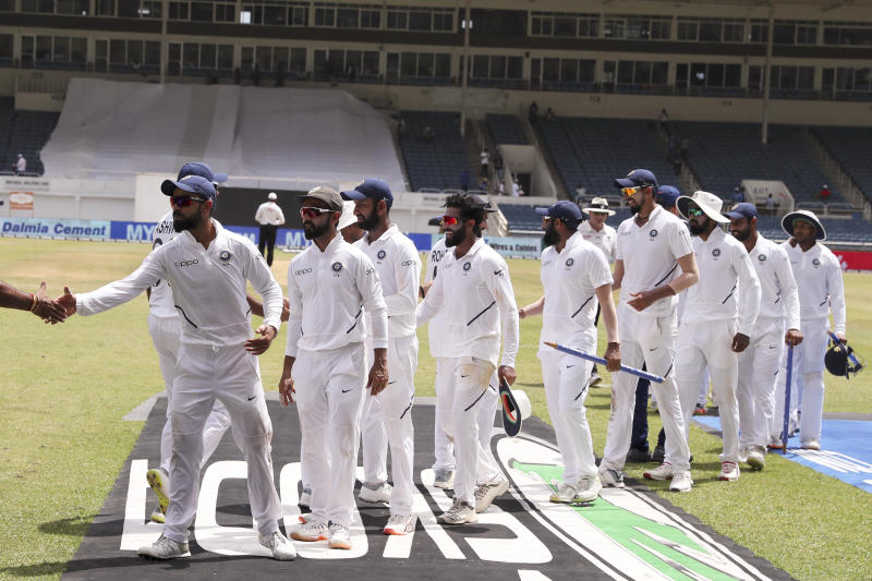 India's captain Virat Kohli leads his team off the filed after day four of the second Test cricket match against West Indies at Sabina Park cricket ground in Kingston, Jamaica Monday, Sept. 2, 2019. India won by 257 runs. (AP Photo/Ricardo Mazalan)