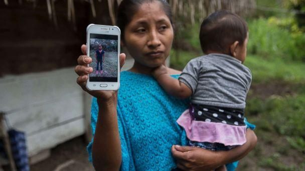 PHOTO: Claudia Maquin, 27, shows a photo of her daughter, Jakelin Amei Rosmery Caal Maquin in Raxruha, Guatemala, Dec. 15, 2018. (Oliver de Ros/AP)