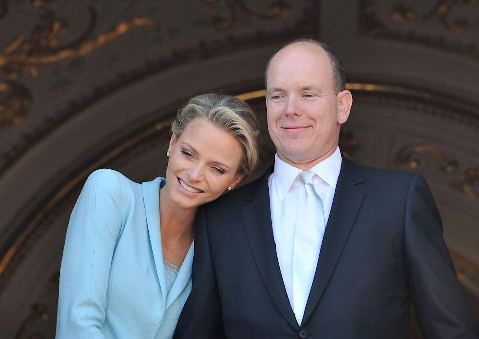"<p>After meeting at a swimming competition in Monte Carlo in 2000, Princess Charlene of Monaco, then 22, and Prince Albert II of Monaco, then 42, dated for ten years before finally getting engaged in 2011. The couple married that same year in a lavish royal wedding, where the bride stunned in a a <a href=""https://us.hellomagazine.com/royalty/gallery/2016070132199/princess-charlene-prince-albert-royal-wedding-anniversary/3/"" rel=""nofollow noopener"" target=""_blank"" data-ylk=""slk:Giorgio Armani gown"" class=""link rapid-noclick-resp"">Giorgio Armani gown</a>.</p>"