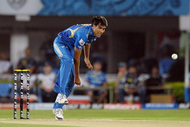 Mumbai Indians bowler Munaf Patel bowls during the IPL Twenty20 cricket match between Deccan Chargers and Mumbai Indians at Dr. Y.S. Rajasekhara Reddy Cricket Stadium in Visakhapatnam on April 9, 2012. AFP PHOTO / Noah SEELAM (Photo credit should read NOAH SEELAM/AFP/Getty Images)