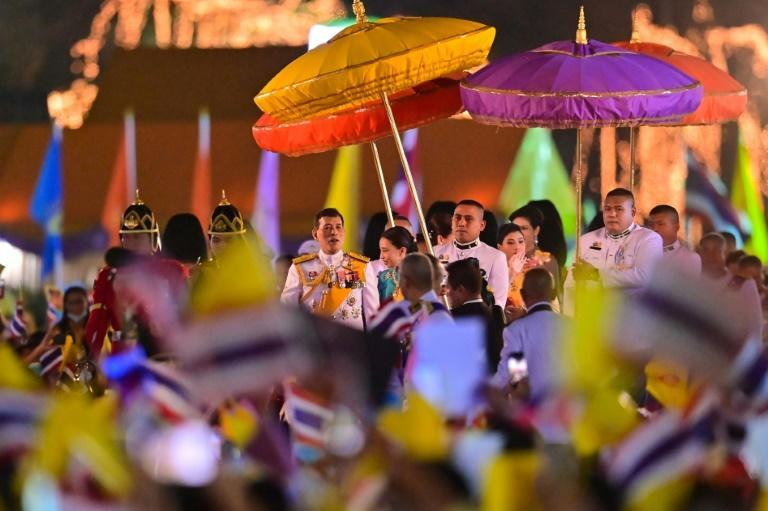 Thailand's King Maha Vajiralongkorn (C) greeted thousands of supporters in Bangkok on Saturday, at an event marking his late father's birthday