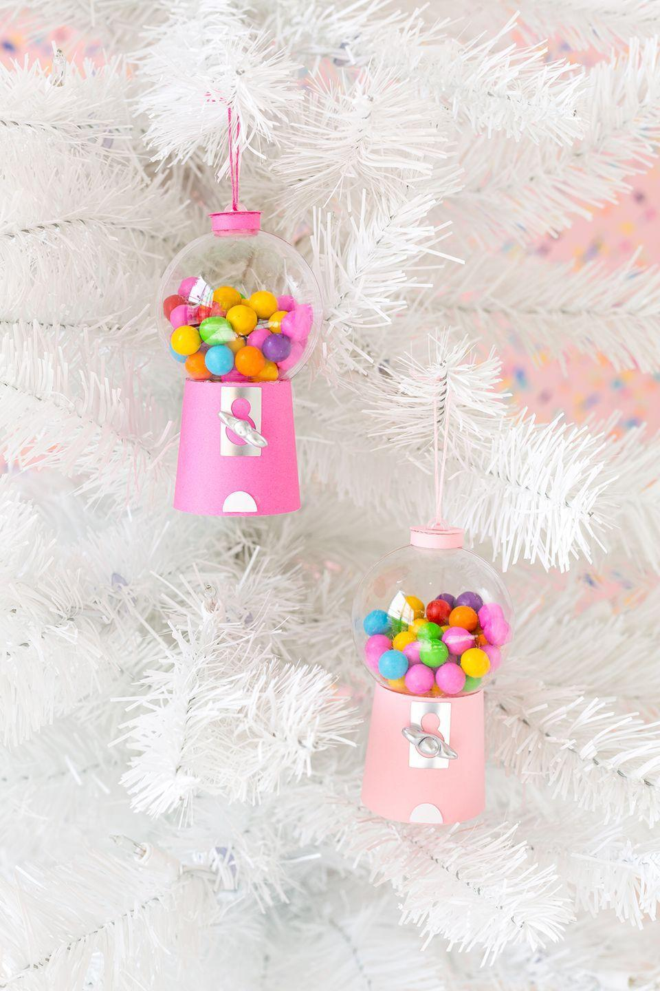 "<p>Turn a clear, plain ornament into a brilliantly vivid mini gumball machine, complete with tiny candies (or pom poms if you prefer). People will be amazed that you made these cute replicas!</p><p><strong>Get the tutorial at <a href=""http://www.awwsam.com/2017/11/diy-gumball-machine-ornaments.html"" rel=""nofollow noopener"" target=""_blank"" data-ylk=""slk:Aww Sam"" class=""link rapid-noclick-resp"">Aww Sam</a>.</strong></p><p><strong><a class=""link rapid-noclick-resp"" href=""https://www.amazon.com/3-Pack-Darice-140mm-Plastic-Ornament/dp/B01F6SXVEC/ref=sr_1_1_sspa?tag=syn-yahoo-20&ascsubtag=%5Bartid%7C10050.g.1070%5Bsrc%7Cyahoo-us"" rel=""nofollow noopener"" target=""_blank"" data-ylk=""slk:SHOP CLEAR BALL ORNAMENTS"">SHOP CLEAR BALL ORNAMENTS</a><br></strong></p>"