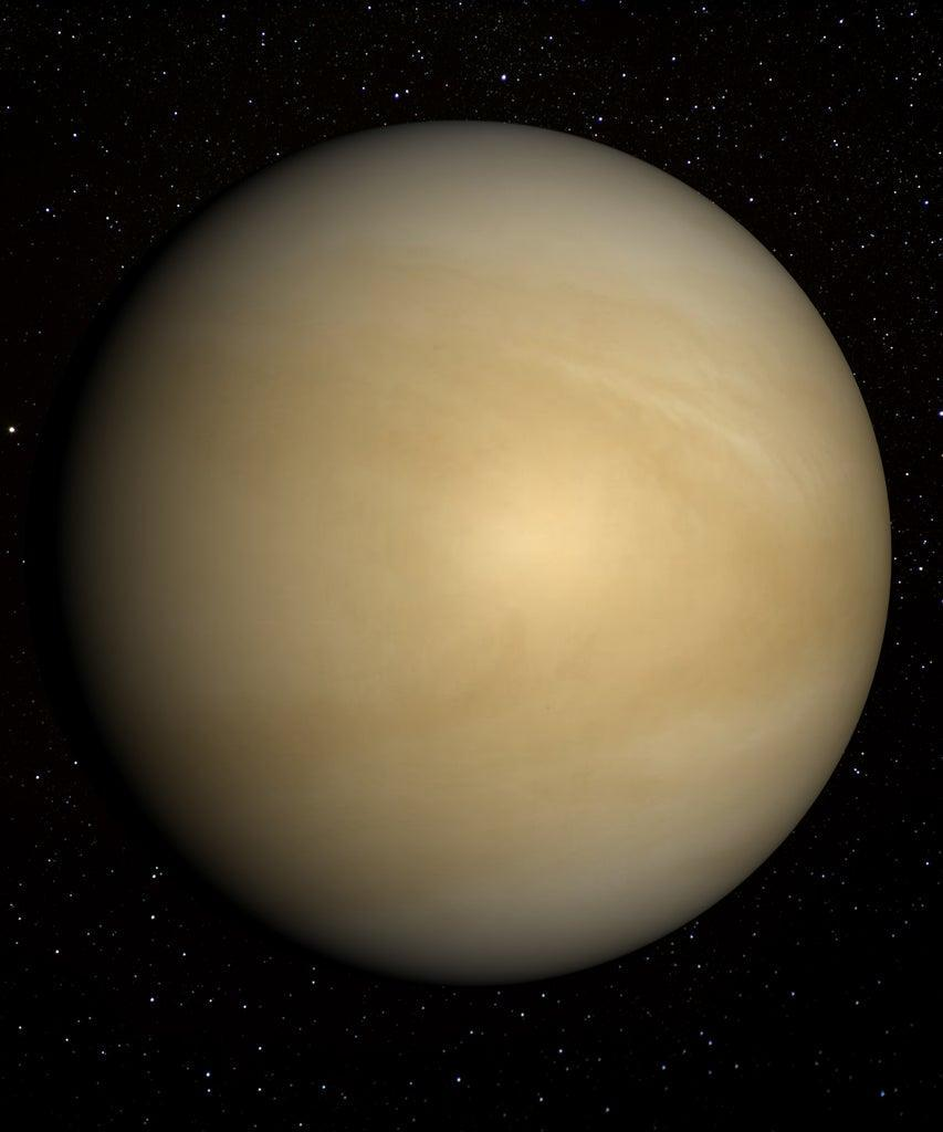 This image shows the visible yellow cloud tops of Venus, rather than the solid surface revealed by radar.