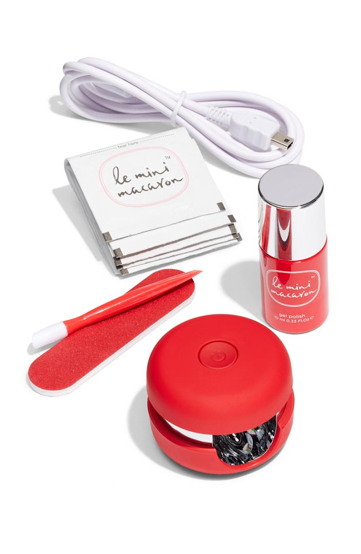 """<p><strong>LE MINI MACARON</strong></p><p>nordstrom.com</p><p><strong>$35.00</strong></p><p><a href=""""https://go.redirectingat.com?id=74968X1596630&url=https%3A%2F%2Fshop.nordstrom.com%2Fs%2Fle-mini-macaron-gel-manicure-kit%2F4537164&sref=https%3A%2F%2Fwww.prevention.com%2Fbeauty%2Fg37678990%2Fbest-nail-polish-gift-sets%2F"""" rel=""""nofollow noopener"""" target=""""_blank"""" data-ylk=""""slk:SHOP NOW"""" class=""""link rapid-noclick-resp"""">SHOP NOW</a></p><p>Gel manicures are a go-to thanks to their staying power. And with this kit, the person on your list can create a salon-worthy nail look at any time. Featuring one gel polish, a macaroon-shaped light, one cuticle stick, and more—this kit makes it easy to save money and time without having to go to the salon.</p>"""