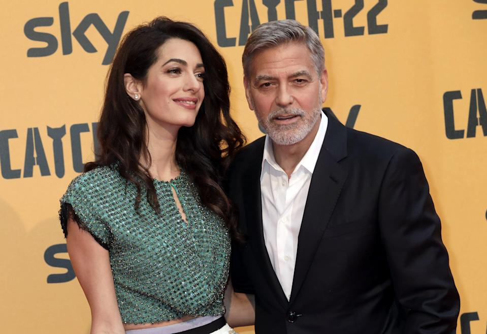 "George Clooney, right, seen with his wife, Amal Clooney, at a 2019 premiere, says Amal is watching ""ER"" episodes and is not impressed with the behavior of his character, Dr. Doug Ross."