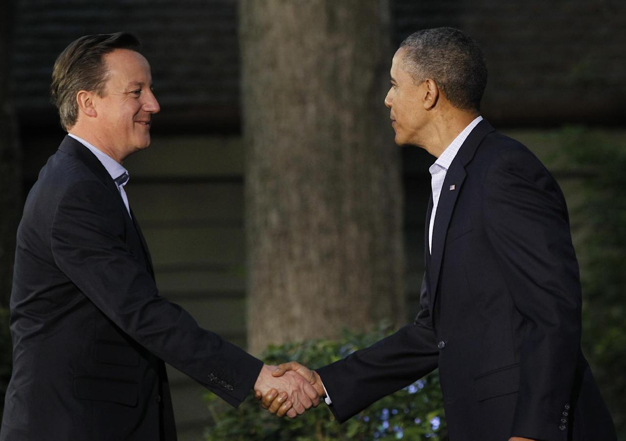 President Barack Obama shakes hands with Britain's Prime Minister David Cameron on arrival for the G8 Summit Friday, May 18, 2012 at Camp David, Md. (AP Photo/Charles Dharapak)
