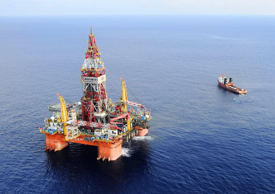FILE PHOTO: In this May 7, 2012 file photo released by China's Xinhua News Agency, Haiyang Shiyou oil rig, the first deep-water drilling rig developed in China by the China National Offshore Oil Corporation, is pictured at 320 kilometers (200 miles) southeast of Hong Kong in the South China Sea. (Jin Liangkuai/Xinhua News Agency via AP, File) NO SALES