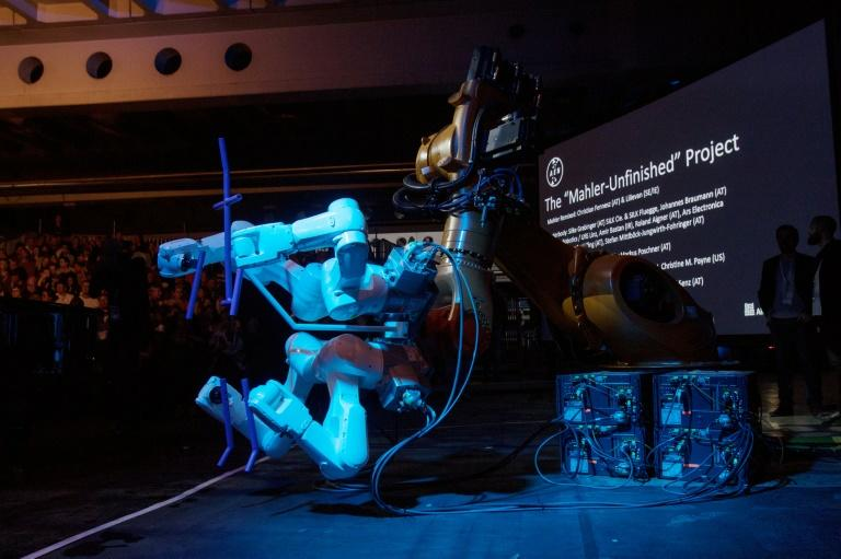 "A robot stands on stage during the ""Mahler Unfinished Project"" at the Ars Electronica in Linz, Austria (AFP Photo/ALEX HALADA)"