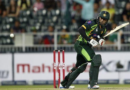 Pakistan's Nasir Jamshed plays South Africa's Lonwabo Tsotsobe delivery during their first Twenty20 cricket match in Johannesburg