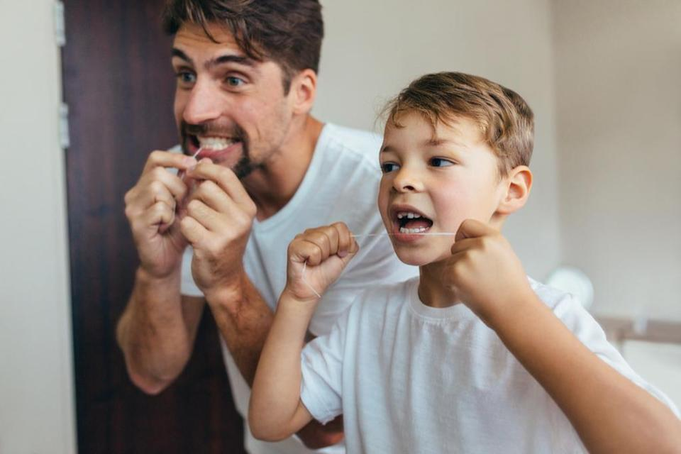 """You've heard it from your dentist a million times, but it's high time you took their flossing advice to heart. According to one 2011 study in the <em>Journal of Aging Research</em>, flossing daily can <a href=""""https://www.ncbi.nlm.nih.gov/pmc/articles/PMC3124861/"""" rel=""""nofollow noopener"""" target=""""_blank"""" data-ylk=""""slk:reduce your risk of death"""" class=""""link rapid-noclick-resp"""">reduce your risk of death</a> by 30 percent."""