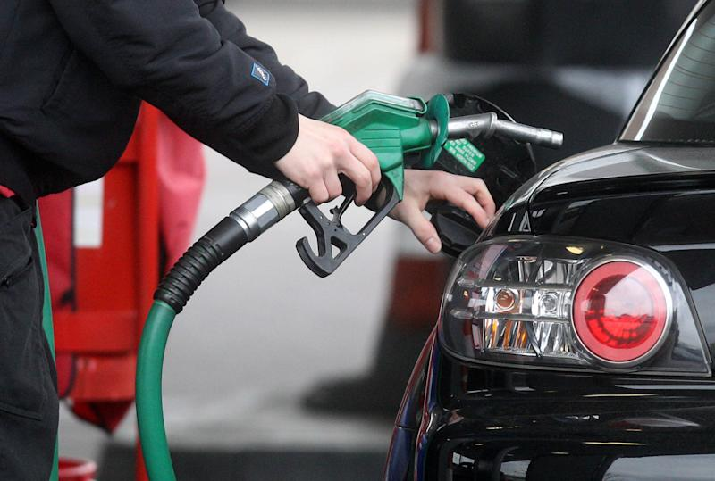 File photo dated 22/02/13 of a person using a petrol pump. Bristol could become the UK's first city to introduce a ban on diesel vehicles to boost air quality.