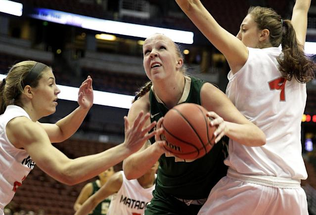 Cal Poly's Molly Schlemer, center, is defended by Cal State Northridge's Randi Friess, left, and Camille Mahlknecht during the first half of an NCAA college basketball game in the final of the Big West Conference tournament, on Saturday, March 15, 2014, in Anaheim, Calif. (AP Photo/Jae C. Hong)