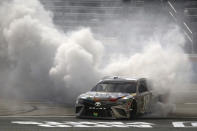 Kyle Busch does doughnuts after winning the NASCAR Cup Series auto race at Texas Motor Speedway in Fort Worth, Texas, Wednesday, Oct. 28, 2020. (AP Photo/Richard W. Rodriguez)