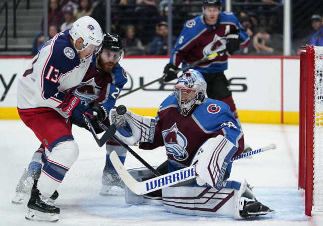 Colorado Avalanche goaltender Pavel Francouz (39) eyes the puck hit off the stick of Columbus Blue Jackets right wing Cam Atkinson (13) as Colorado Avalanche defenseman Ian Cole (28) looks on during the third period of an NHL hockey game, Saturday, Nov. 9, 2019, in Denver. (AP Photo/Jack Dempsey)
