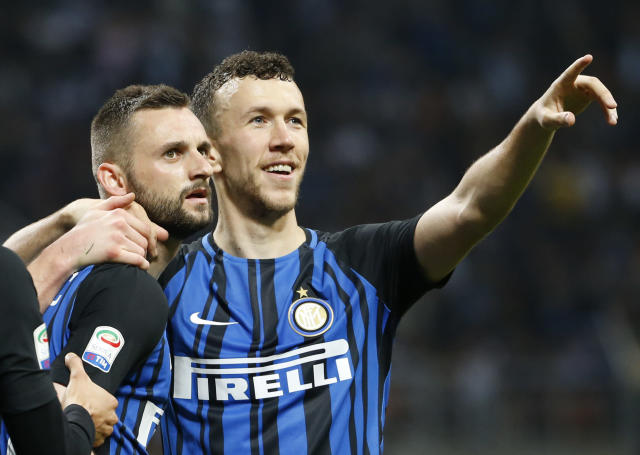 Inter Milan's Marcelo Brozovic celebrates with teammate Inter Milan's Ivan Perisic, right, after scoring his side's third goal during an Italian Serie A soccer match between Inter Milan and Cagliari, at the San Siro stadium in Milan, Italy, Tuesday, April 17, 2018. (AP Photo/Antonio Calanni)