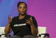 """FILE - In this Feb. 11, 2019, file photo, Patrisse Cullors, Black Lives Matter co-founder, participates in the """"Finding Justice"""" panel during the BET presentation at the Television Critics Association Winter Press Tour at The Langham Huntington in Pasadena, Calif. The Black Lives Matter Global Network Foundation, which grew out of the creation of the Black Lives Matter movement, is formally expanding a $3 million financial relief fund that it quietly launched in February 2021, to help people struggling to make ends meet during the ongoing coronavirus pandemic. """"This came from a collective conversation with BLM leadership that Black folks are being hurt the most financially during the pandemic,"""" Cullors told The Associated Press. (Photo by Willy Sanjuan/Invision/AP, File)"""