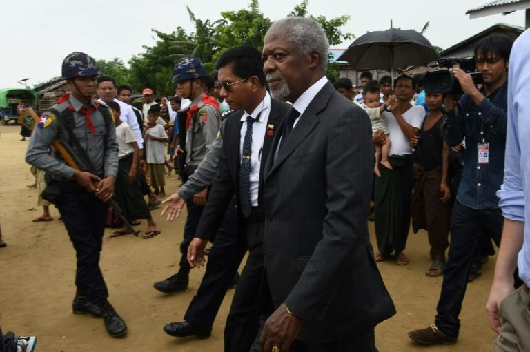 A commission led by former UN secretary general Kofi Annan (C) called on the Myanmar government to close displacement camps in strife-torn Rakhine state
