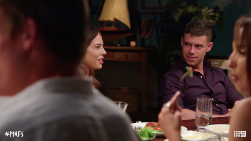 Michael looks at KC during a dinner party on MAFS