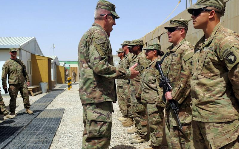 U.S. Army General John Nicholson, commander of Resolute Support forces and U.S. forces in Afghanistan, talks to U.S. soldiers - Credit: REUTERS