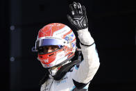 Williams driver George Russell of Britain waves to the fans at the end of the qualifying session ahead of Sunday's British Formula One Grand Prix, at the Silverstone circuit, in Silverstone, England, Friday, July 16, 2021. (Lars Baron/Pool photo via AP)