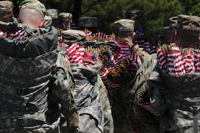 <p>U.S. Army soldiers of the 3rd United States Infantry Regiment arrive with sacks of U.S. flags to place on Arlington National Cemetery graves in advance of Memorial Day in Arlington, Va., May 24, 2018. (Photo: Jonathan Ernst/Reuters) </p>