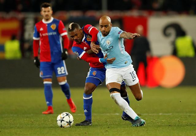 Soccer Football - Champions League - Basel vs Manchester City - St. Jakob-Park, Basel, Switzerland - February 13, 2018 Basel's Serey Die in action with Manchester City's Fabian Delph Action Images via Reuters/Andrew Boyers